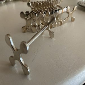 18 porte couteaux en métal argenté décor flocon
